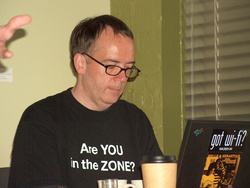 Nigel sitting quietly in the corner, dodging Darrin's hand gestures. -Karol